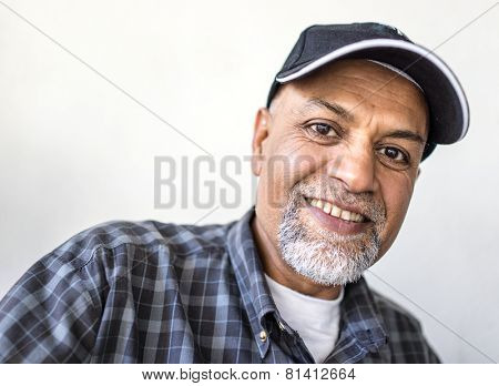 Senior Arabic Pakistani man portrait with hat