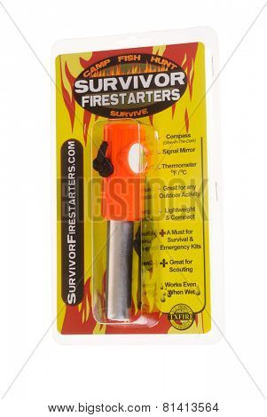 Hayward, CA - January 27, 2015: SURVIVOR FIRESTARTERS survival tool, firestarter, compass, mirror, thermometer