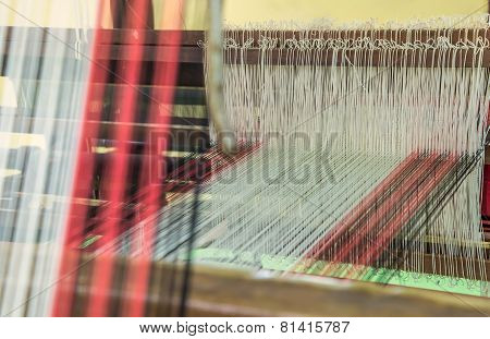Weaving Loom And Shuttle On The Warp.