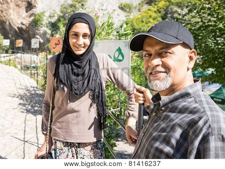 Arabic Muslim Middle Eastern girl with her father having vacation trip