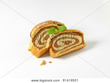 three slices of nut roll with crumbs