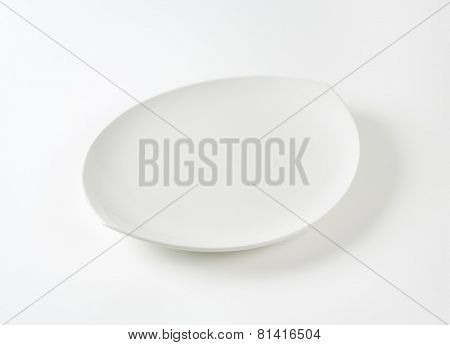 Oval white porcelain plate with pointed ends
