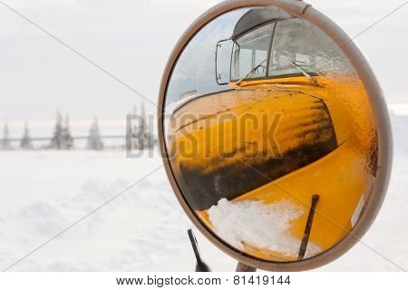 Yellow School Bus Reflected In Side View Mirror