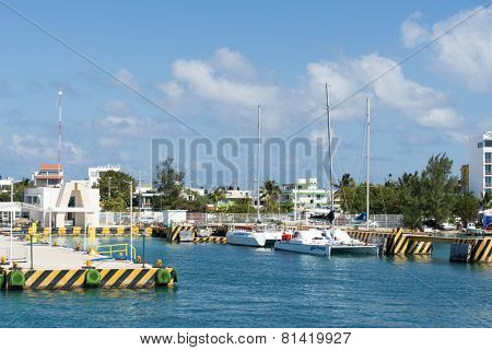 ISLA MUJERES - JANUARY 21: View of the ferry port on 21 January 2015 in Isla Mujeres, Mexico. The island is located 8 miles east of Cancun in the Gulf of Mexico.