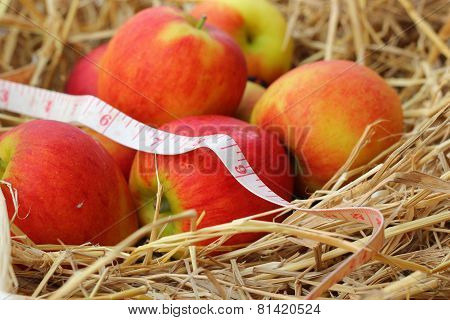 Measuring Tape And Red Apple