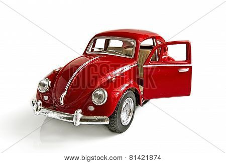 The Red Toy Car With An Open Door