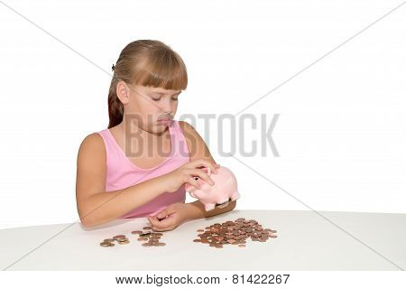 Sad Girl Looking At The Piggy Bank Isolated
