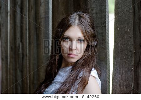 Woman Against A Wooden Wall