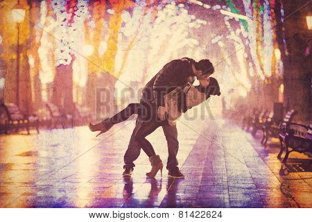 Couple Kissing At Night Alley.