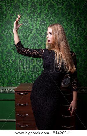 Girl In Black Dress On Vintage Interior
