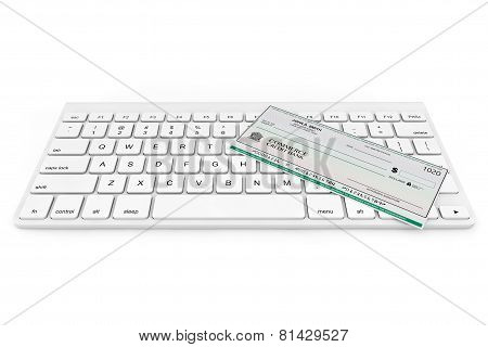 Banking Check Over Computer Keyboard