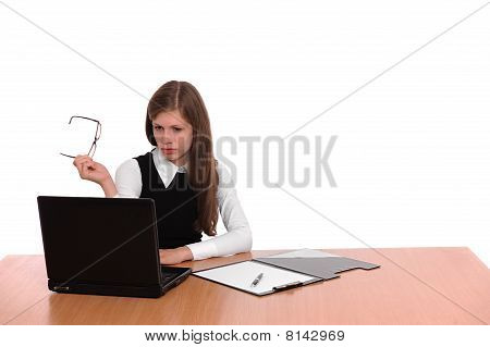 Worried business woman working on a laptop