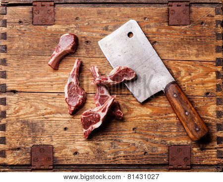Raw Fresh Lamb Ribs And Meat Cleaver On Wooden Background
