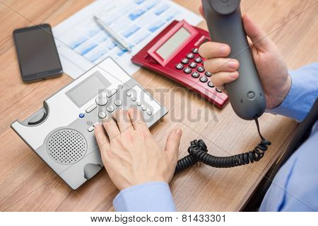 Occupied Businessman With Report  Is Calling Client For Explanation