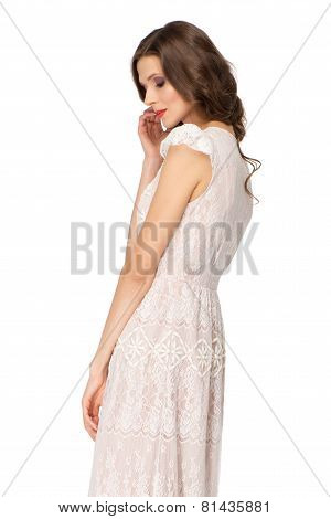 Back shot of young woman wearing dress