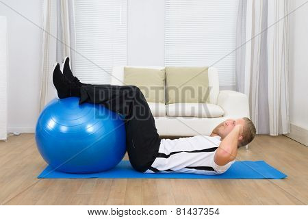 Man Doing Exercise With A Pilates Ball