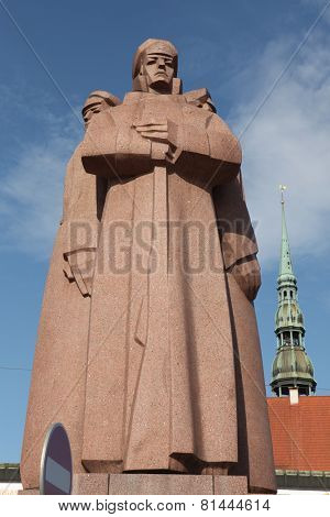 RIGA, LATVIA - AUGUST 4, 2013: Soviet era monument for the Latvian Riflemen in Riga, Latvia.