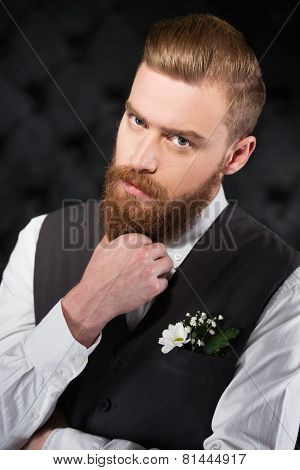 Stylish and bizzare man with beard