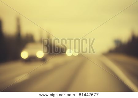 Road track and Cars headlights Background Blurred Travel concept retro film colors
