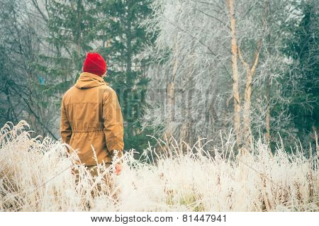 Young Man walking alone outdoor Travel Lifestyle