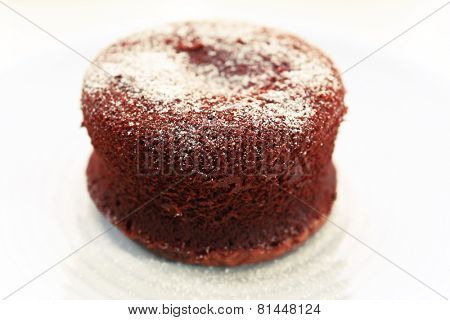 Hot chocolate pudding with fondant centre on plate, close-up