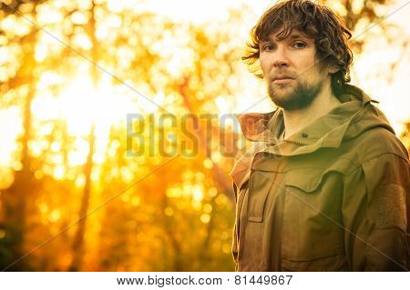 Young Man standing alone in forest outdoor with sunset nature