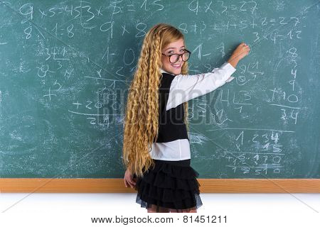 Clever nerd pupil blond girl writing in green board student schoolgirl