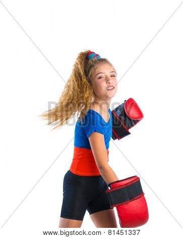 boxer kid blond girl with funny boxing gloves kidding aggressive gesture expression