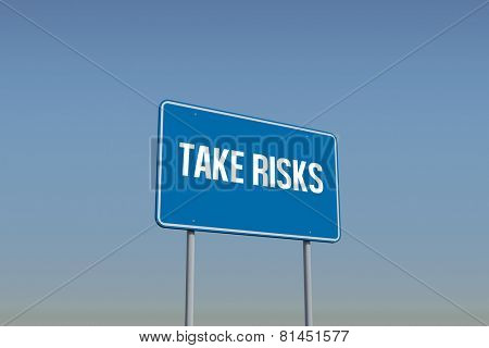 The word take risks and blue billboard sign against blue sky