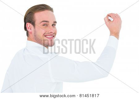 Cheerful businessman writing with marker on white background