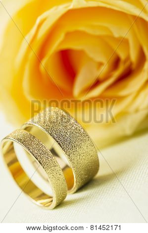 Yellow Rose With Two Elegant Wedding Rings