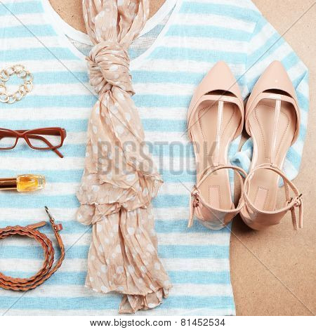 Fashionable female clothing and accessories, on wooden background