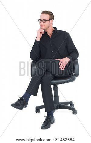 Thoughtful businessman sitting on a swivel chair on white background