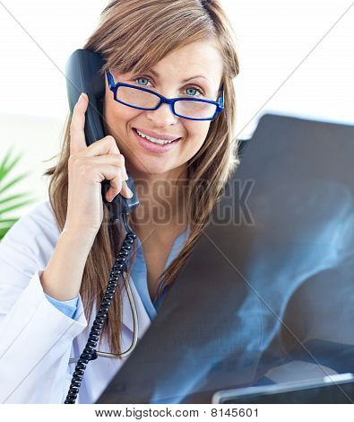 Beautiful Female Doctor With Glasses Sitting In Office