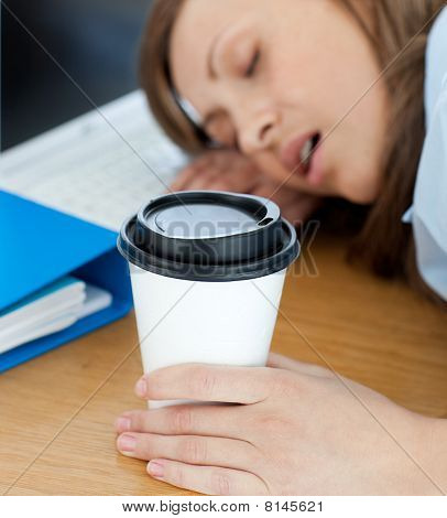 Languorous Woman Sleeping On Table In Office