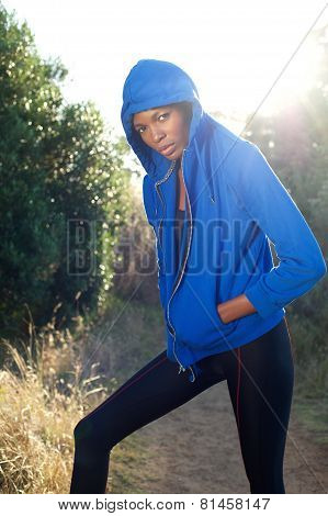 Fashion Fitness Model Posing In Blue Sweatshirt Outdoors