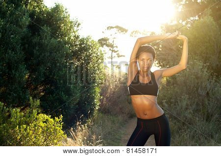 Female Fitness Sports Model Stretching Outdoors