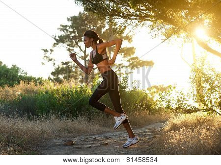 Active African American Woman Running Outdoors