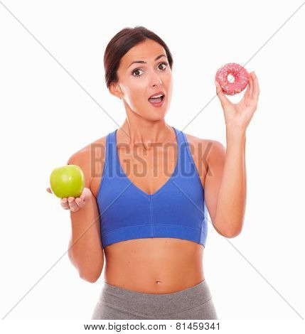 Surprised Young Woman Holding Food Temptations