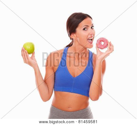 Lady In Sportswear Biting Sugary Cake