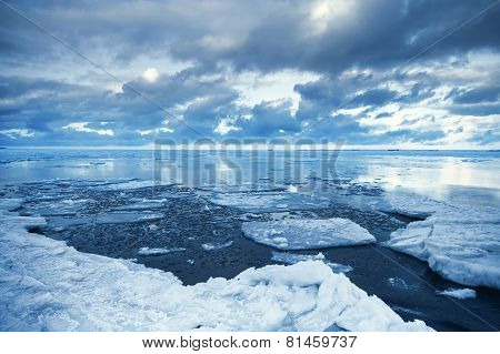 Winter Coastal Landscape With Floating Melting Ice Fragments