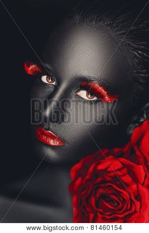 close-up fashion portrait of a dark-skinned girl with color make-up