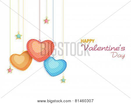 Happy Valentine's Day celebration greeting card decorated by colorful glossy hanging hearts and stars on white background.