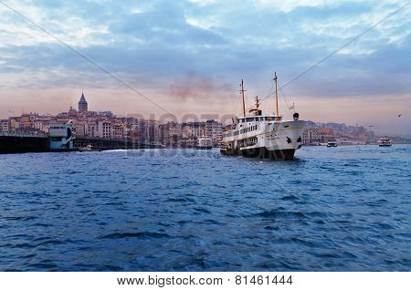 Passenger ship in Bosporus near Galata bridge