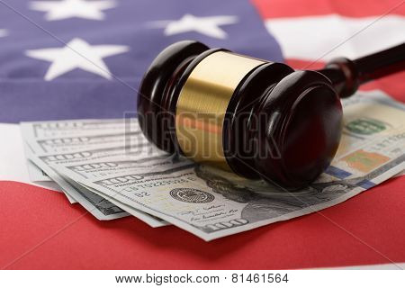 Gavel On Usa Dollar Banknotes And Us Flag
