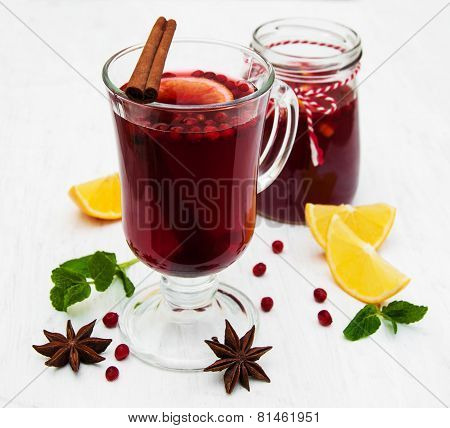 Glasses Of Mulled Wine With Lemon And Cranberries