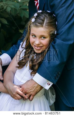 Little Girl In Her First Communion Day With Her Father