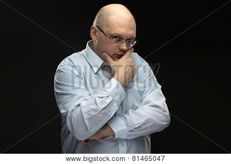 Photo of thinking man in glasses