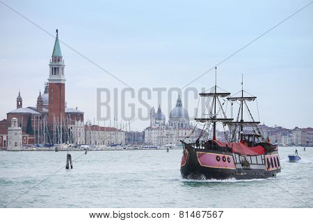 Galleass Sailing In Italian Water Canal