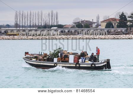 People Sailing In Water Canal